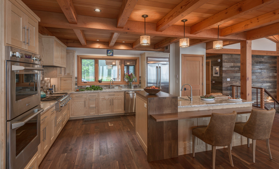 "A ""waterfall"" of walnut flows over the bright Ash of the Olsen's kitchen island."