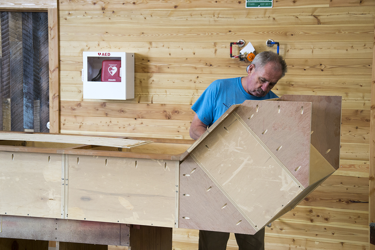 Gediminas works on the upper cabinets for the break room. Yes, our cabinet makers made their own cabinets.