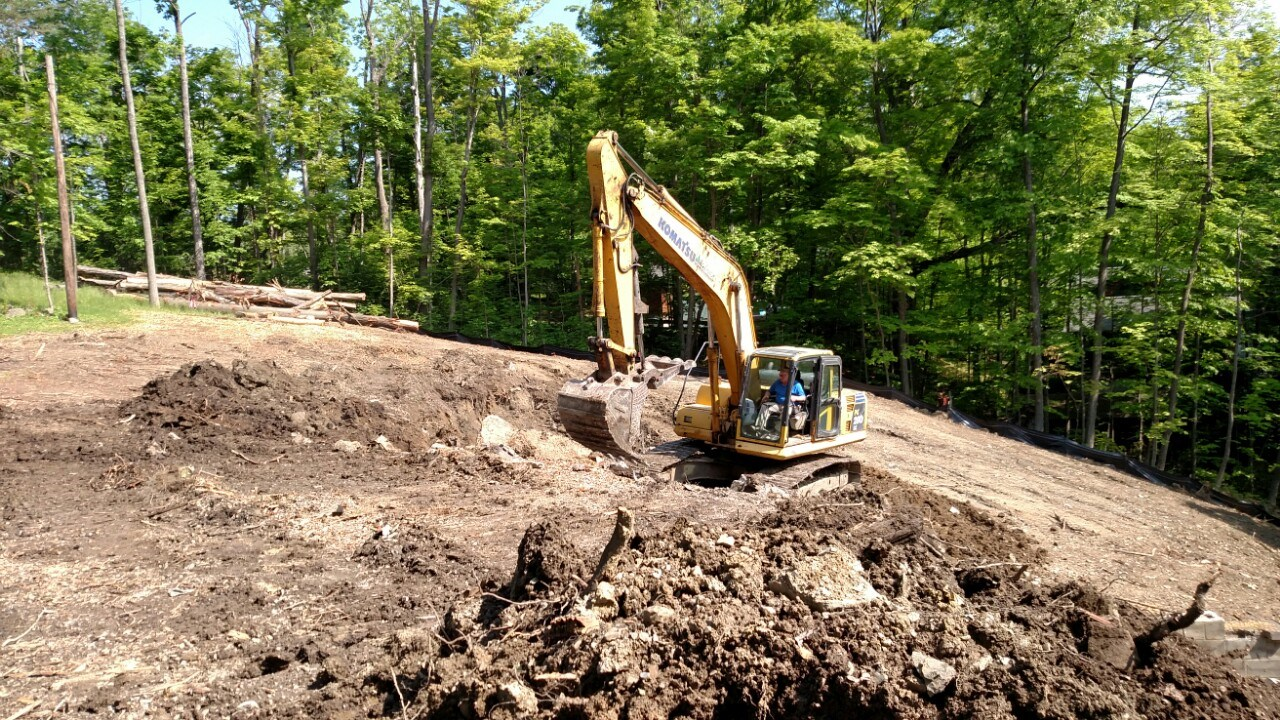 Extensive excavation and landscaping work was the first step in preparing Dan and Laurie's site for their new home.