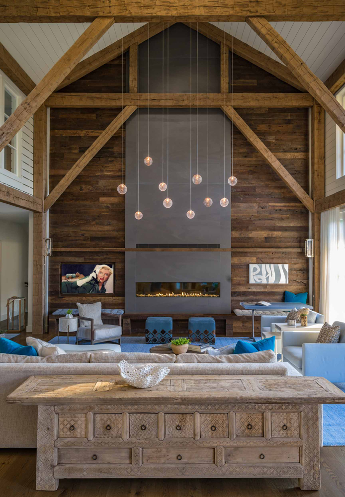 Applied hand-hewn timbers with a custom stain in this Massachusetts home. Photo: Eric Roth Photography.