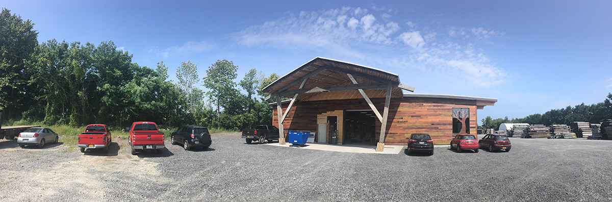 We're finishing the exterior siding of the CLT building, which is Pioneer Millworks Shou Sugi Ban Color Char. It's nice to see the woodworkers' cars out front.