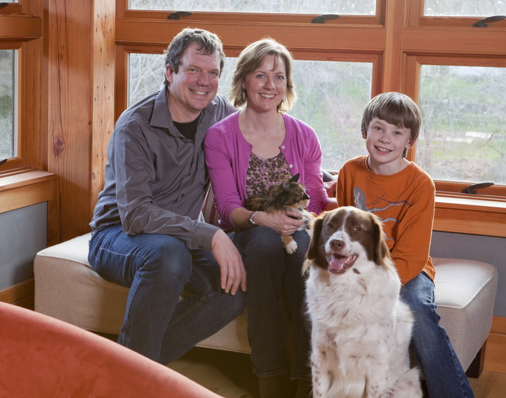 Jonathan Orpin, Maxine Bromfield (with Annie) and their son, Jake Orpin (with Dexter) moved into their home at the end of 2009 and feel now as if they are getting in the rhythm of the house, using and enjoying what each space offers. Photo by Stephen Cridland