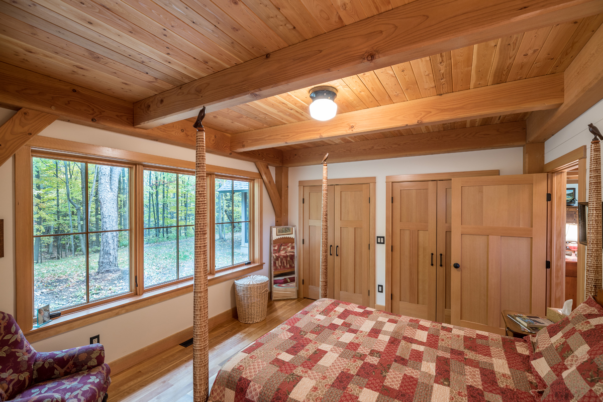 Master suite with forest views. Photo (c) Scott Hemenway.