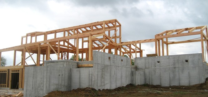 On a stormy day the frame was raised for our Lone Jack couple's Missouri timber frame home.