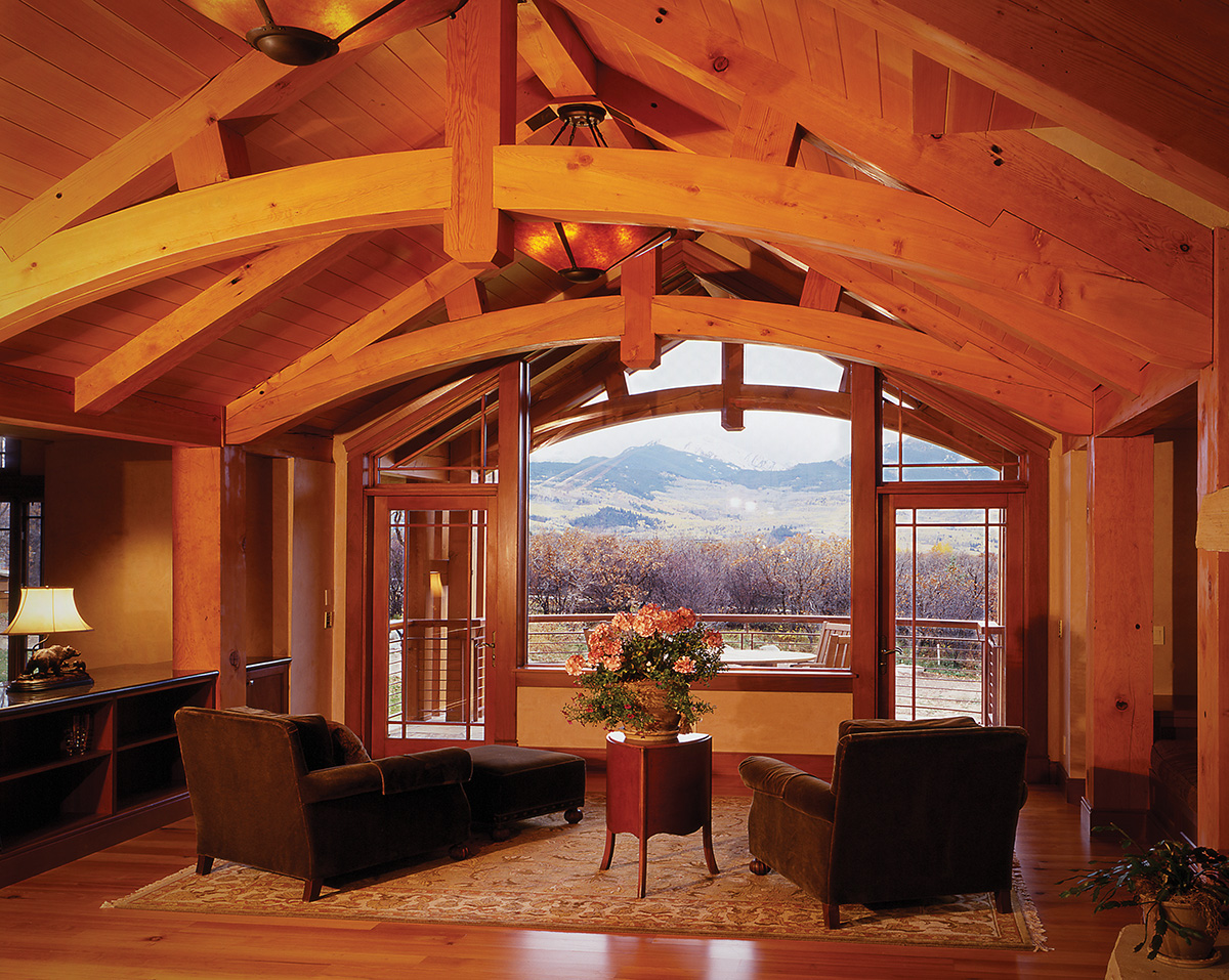 Classic oiled Douglas fir timbers in this Colorado mountain timber frame home.