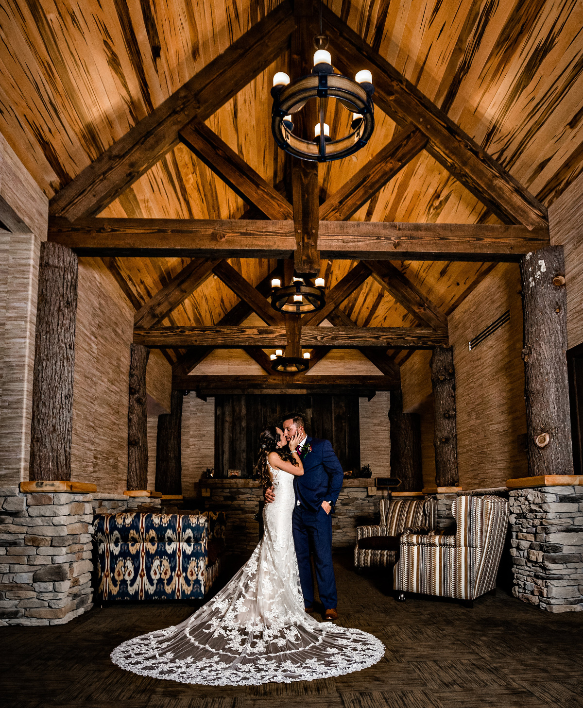 Timber frame bents frame the more intimate spaces of Tailwater Lodge's, The Barn. Photo c Cylinda B Photography.