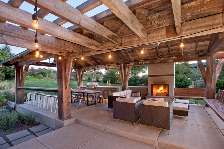 As-found industrial timbers celebrate original surfaces for this Washington family's outdoor living space.