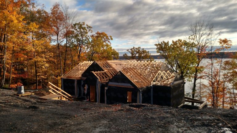 Autumn colors decorated the lake views during construction of Laurie and Dan's home.