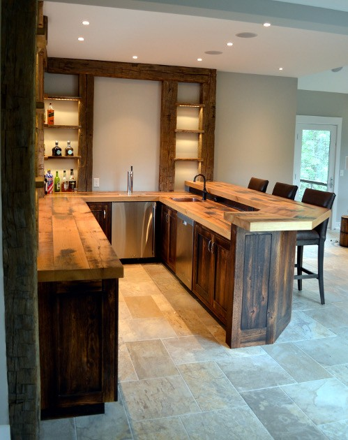 A bar island crafted from reclaimed wood – tops and cabinetry – with shelving from agricultural salvaged timbers.