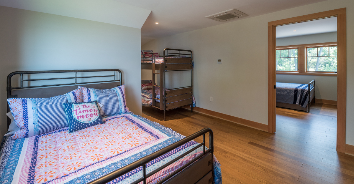 Near 5,000 sq ft total, the home includes bunk rooms over the garage, two guest rooms, the master suite, and one guest suite all meant to comfortably accommodate many for long weekends at the lake. Photo (c) Scott Hemenway