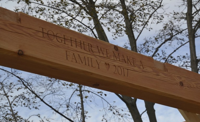 We particularly enjoyed carving the heart shape for this custom engraving on one of the frame's central timber beams.