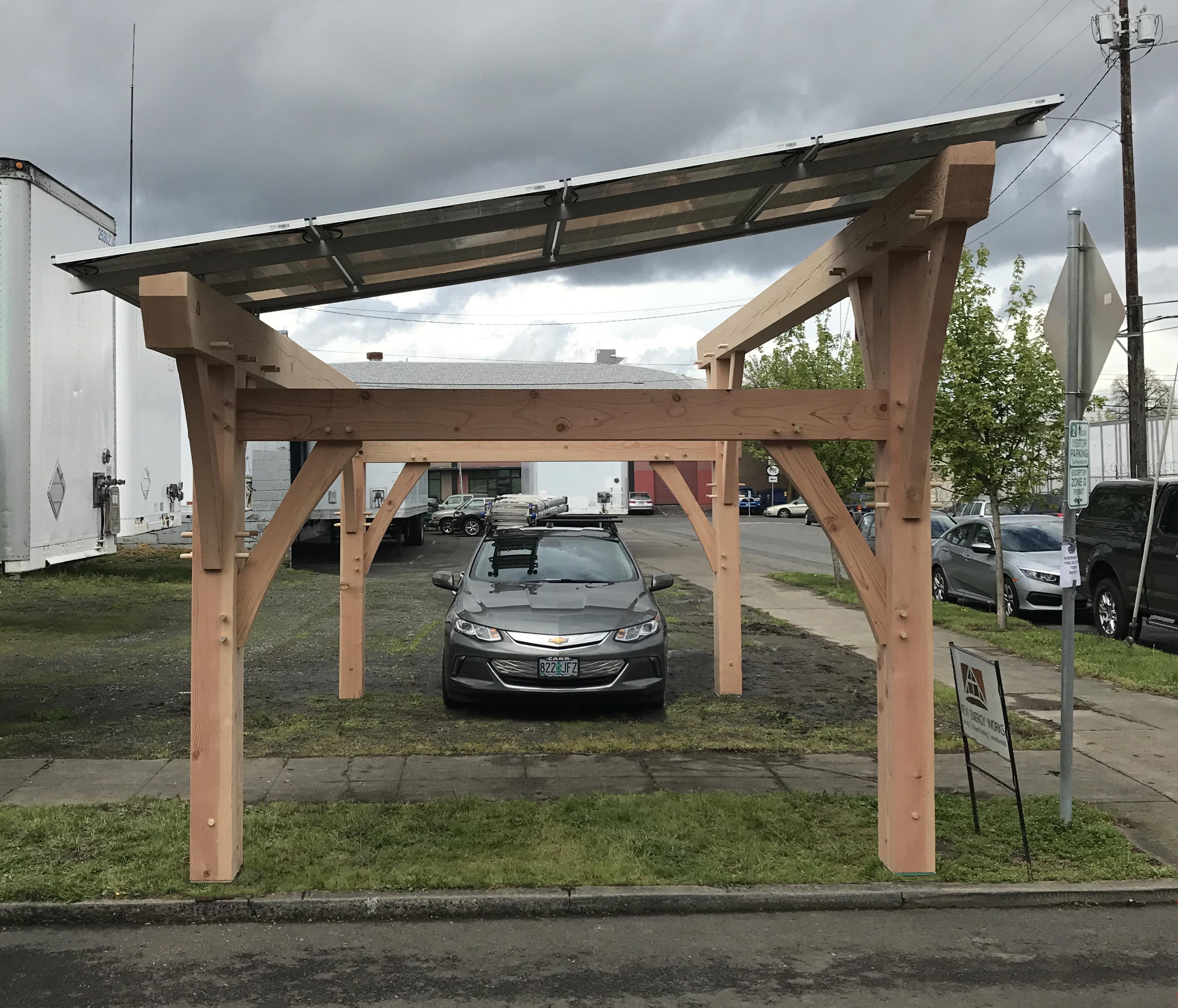 4 solar panels atop Douglas fir timbers