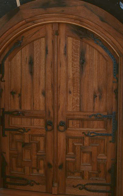These reclaimed oak doors are both arched and curved to match the walls of a circular zen center.