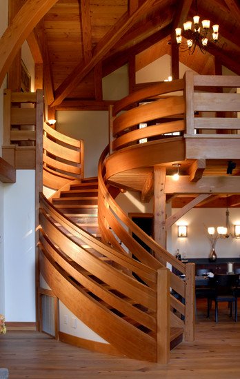 This custom staircase curves and tapers as it reaches the second level. Calculations in CAD, a small scale model, and decades of woodworking experience brought this masterpiece to life. (Crafted of reclaimed Douglas fir and industrial salvaged Jarrah.)