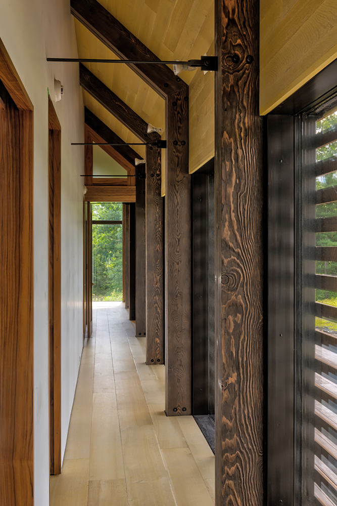 A multi-step finish gave a dark tone with highlighted grain patterns on the solid Douglas fir timbers crafted for this Hudson Valley NY project. Photo by Chris Kendall Photography.