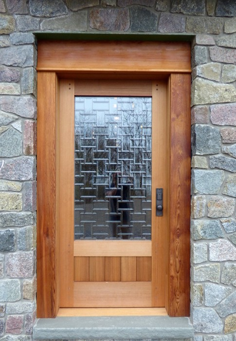 A custom glass mosaic was fitted to a side door for Ross and Anna-Marie's home on Lake Erie in New York.