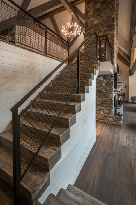 Minimalist metal railing offsets heavy timber treads, customized by NEWwoodworks to match the timber frame tone/texture.