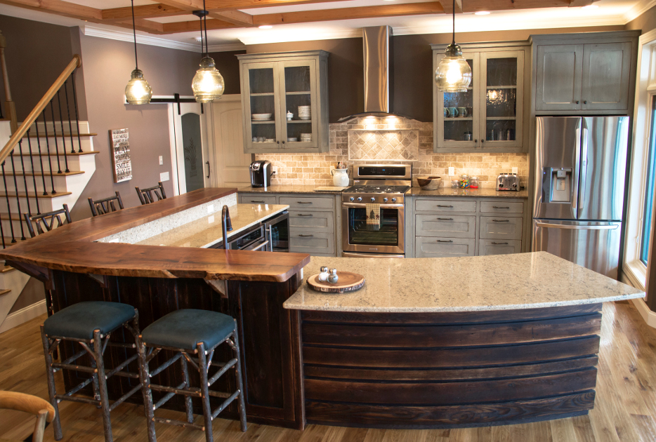 "A split level island puts wood where the elbows are using live-edge walnut atop reclaimed ""toasted"" oak."