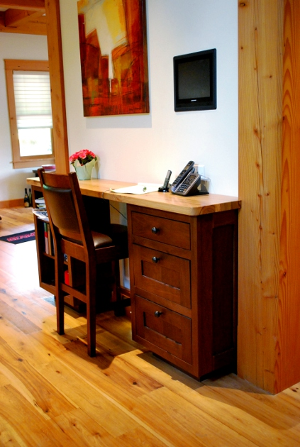 Located against a narrow wall that helps define the kitchen from the dining room, this is a desk style command center.