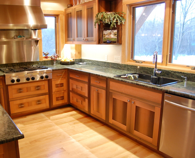 Tim and Laurie's kitchen cabinetry was crafted from Douglas fir timbers that spent a century underwater as a canal lock. The wood carries signs of its previous life with mineral staining and tight grain patterns.