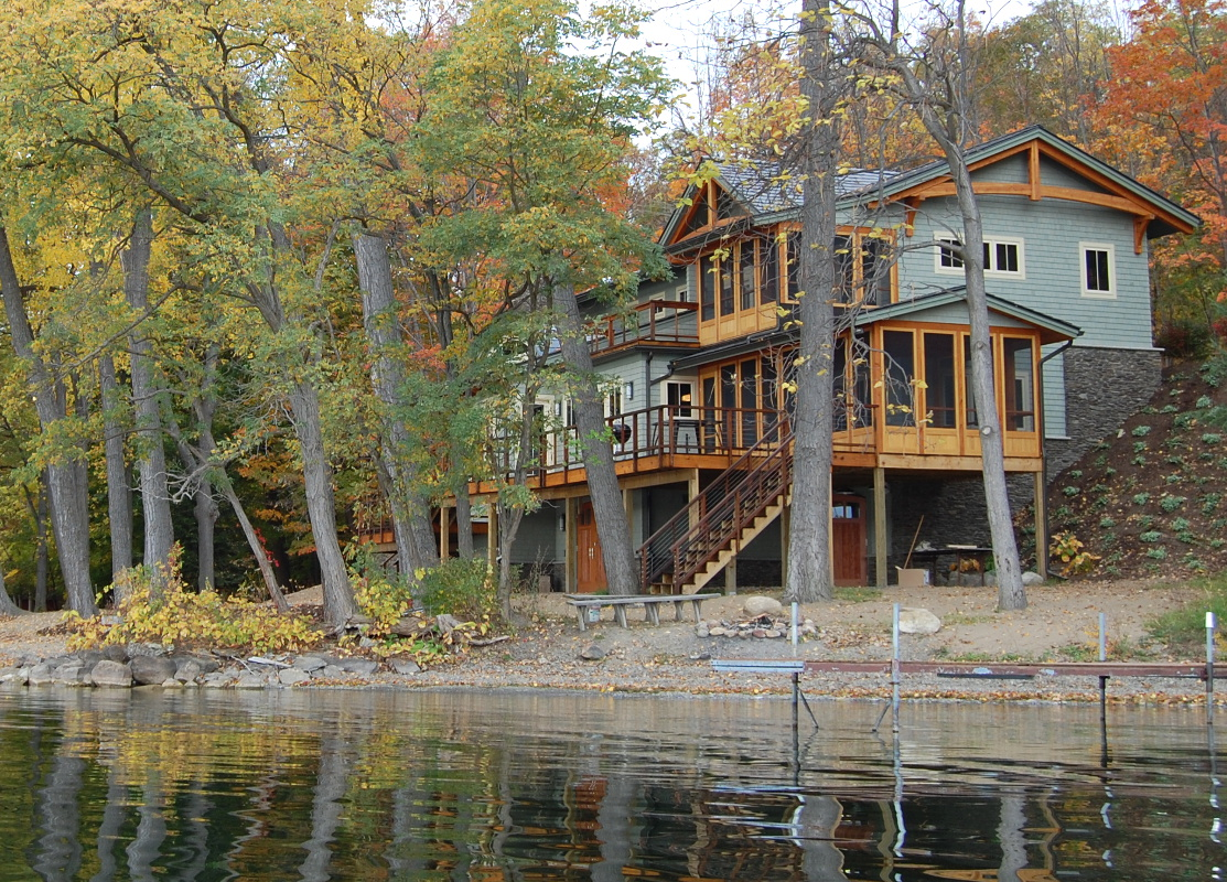 Multiple level screened porches and an open deck help the family make the most of lake living.