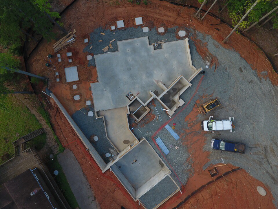 """An aerial view of the foundation shows the """"kinked"""" or """"L"""" shaped layout of the home."""