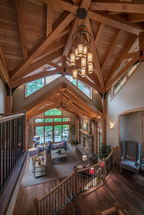 """See more on this lake home with timber frame """"tower"""" in our case studies."""