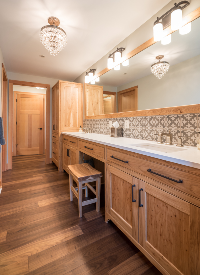 Hickory, rampant with an almost burled grain, was selectively incorporated throughout the master bath double vanity and cabinetry as well as the master closet built-ins.