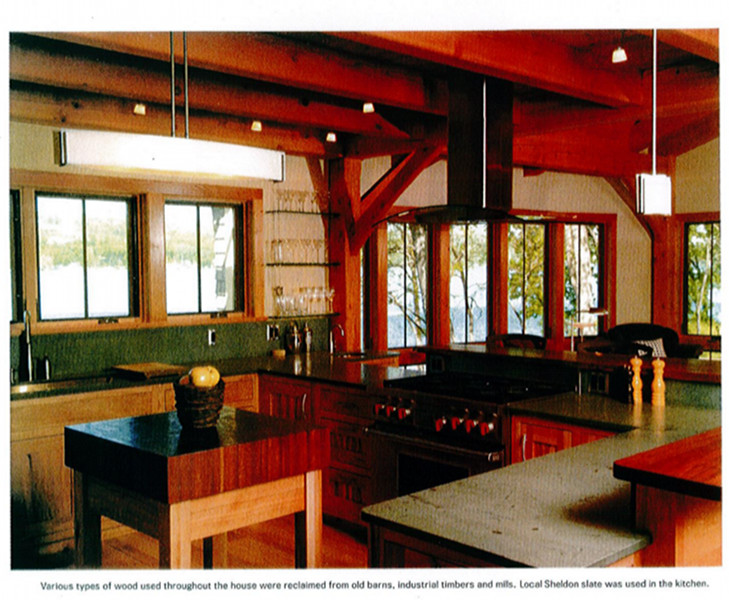 Various types of wood used throughout the house were reclaimed from old barns, industrial timbers and mills. Local Sheldon Slate was used in the kitchen.