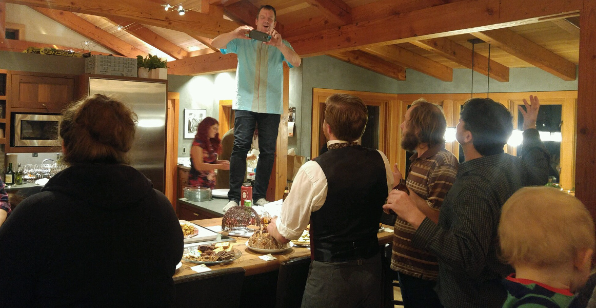 Kitchen islands—central for gathering, food, and when necessary a spot to perch for a great photo op as Jonathan demonstrates!