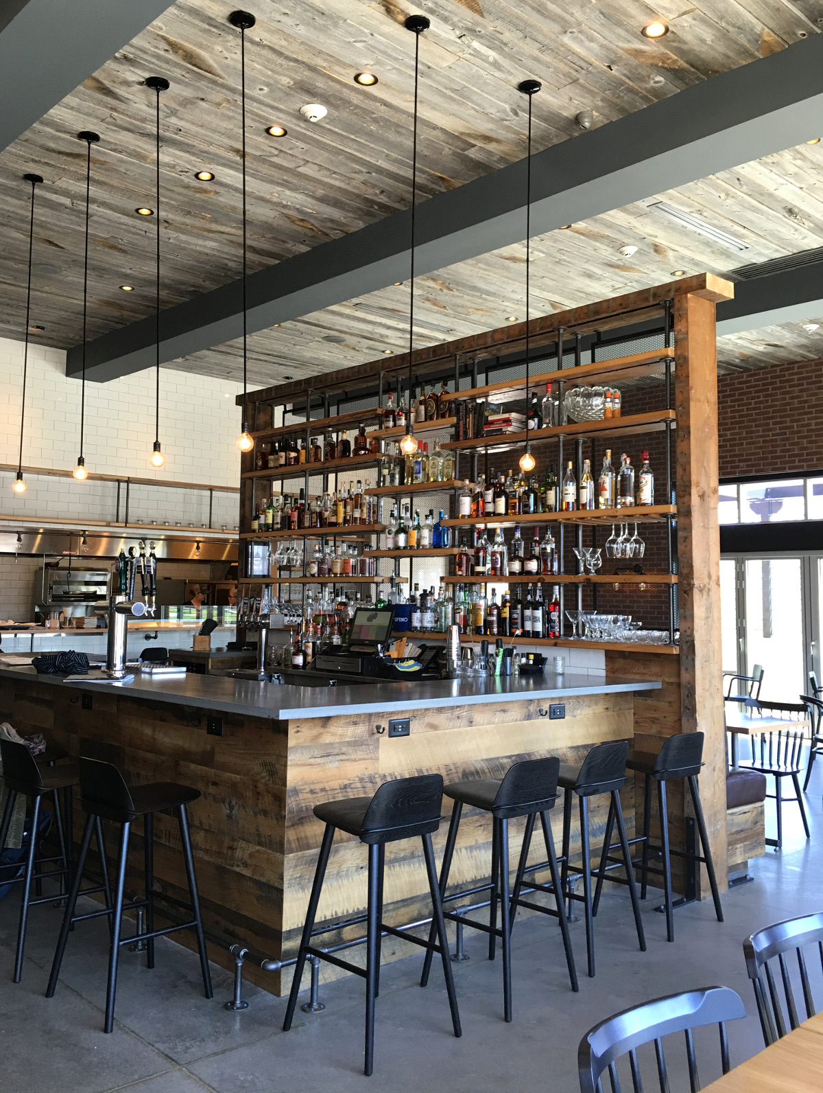 Kindred Fare bar from front to shelving was crafted of reclaimed wood by NEWwoodworks.