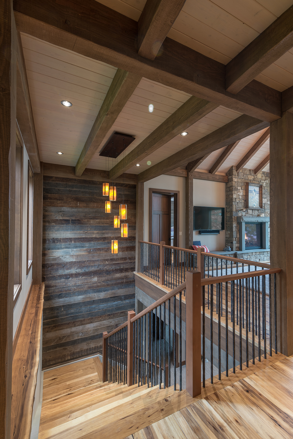 """Stairs are also directional. In this lake home, the stair leads to the lake level and as it turns it delivers you heading towards the lake, suggesting a flow from inside to outside,"" shared Ty. Photo by Scott Hemenway."