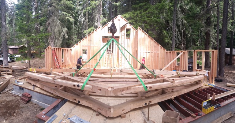 A pre-assembled timber bent, strapped and ready for raising.