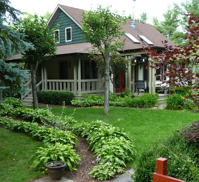 We designed this Skaneateles, New York bungalow home almost 17 years ago. A few recent photos from David reminds us how timeless architecture gets better with each year. And that you can never go wrong with a big porch!