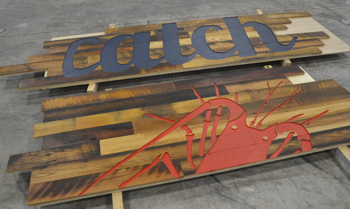 Reclaimed hardwoods from Pioneer Millworks were pre-panelized and then carved on Thelma (the NEWwoodworks CNC) for the Florida eatery.