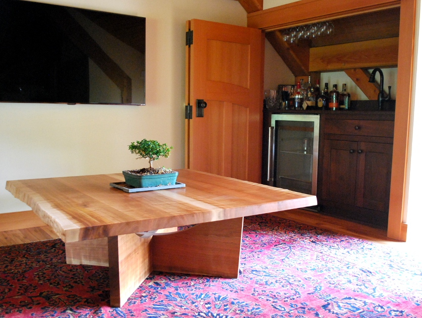 Figured cherry maintains a live edge with a low height traditional for coffee tables.