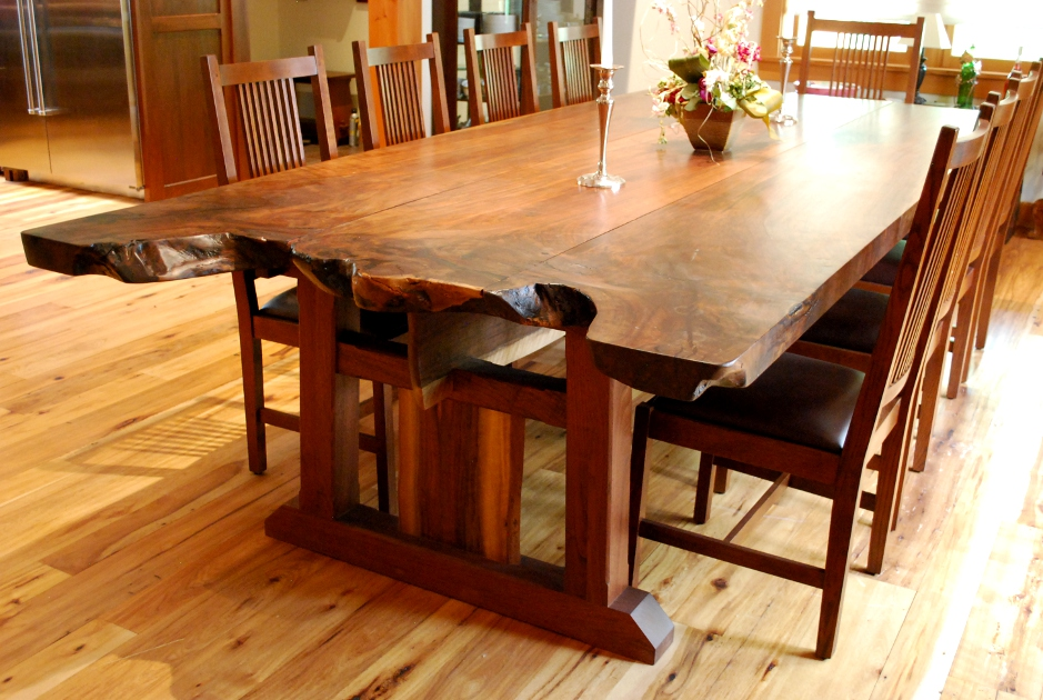 The root burl of a large walnut tree was carefully maintained to create a live-edge end on this farmhouse table.