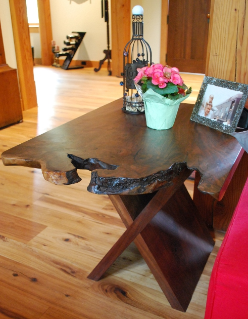 Similar to the dining table, walnut end tables have one-of-a-kind live-edges in this Kentucky home.