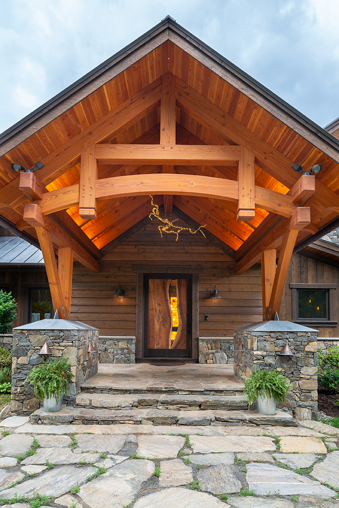 The main entry introduces visitors to the wood, stone, and steel elements that are integrated throughout the home.