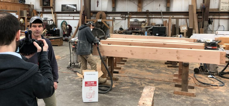 Mike, shop foreman and master timber framer, was at ease on camera, explaining some of the final steps coworkers Zane and Jason were taking with the bank timbers.