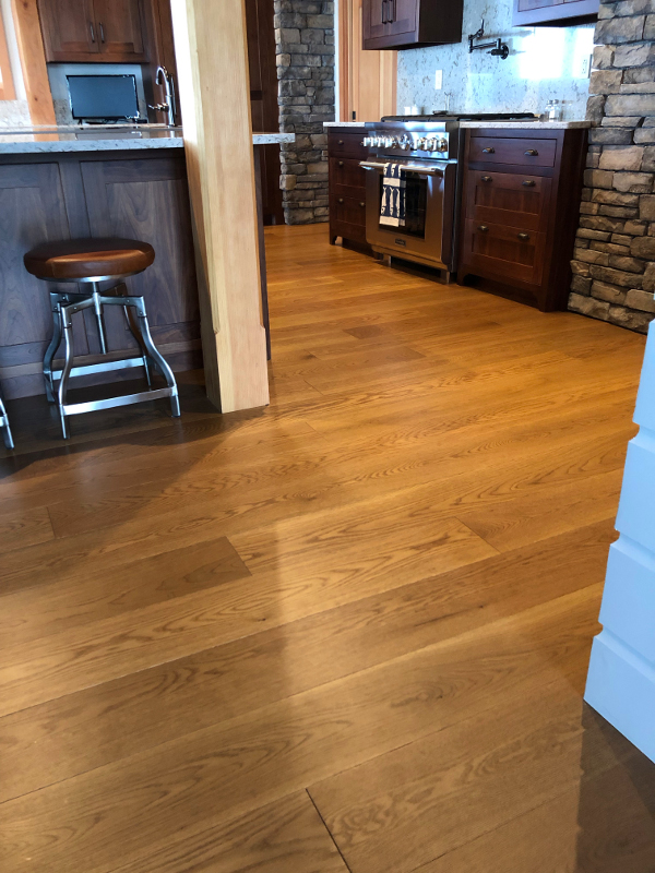 Modern Farmhouse Clean White Oak flooring in wider widths with a custom tinted UV oil finish – from our sister company, Pioneer Millworks.