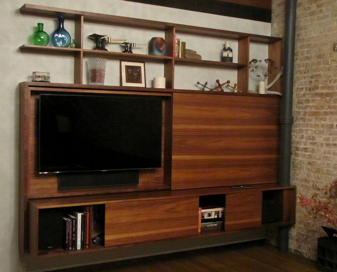 Floating, sliding, open, unembellished, clean grained–this custom entertainment center tucked into a modern city loft is all about mod.