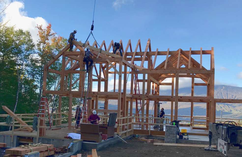 Mike, Pete, Rick, and Matt raising the frame for Julie and Hank's home in Vermont.