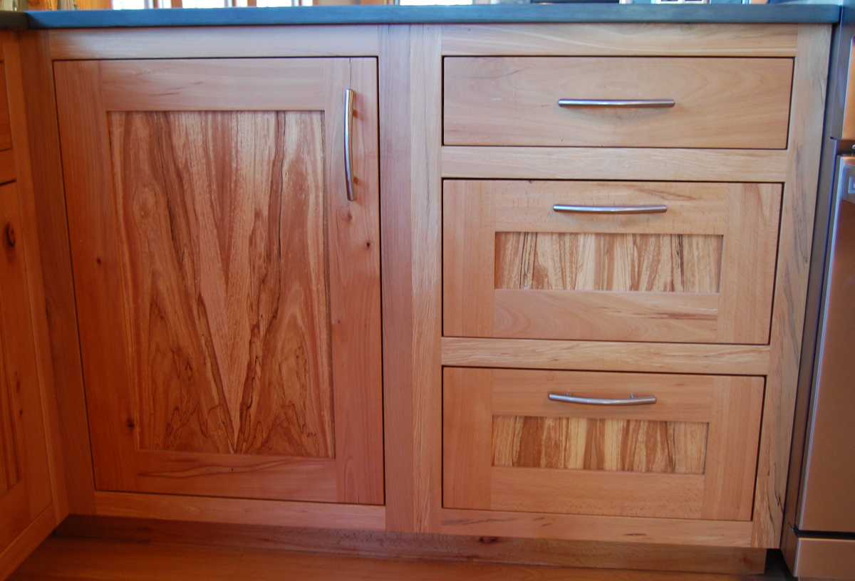 Spalting was celebrated and grain matching flows throughout all of the handcrafted cabinetry made by NEWwoodworks.
