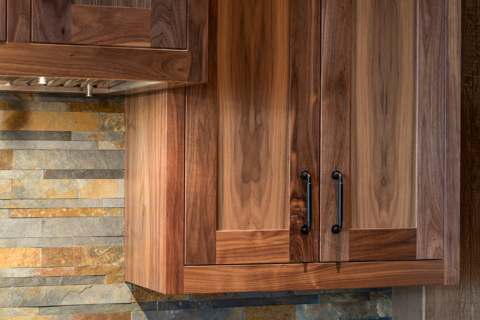 Custom walnut kitchen cabinetry, crafted by NEWwoodworks.