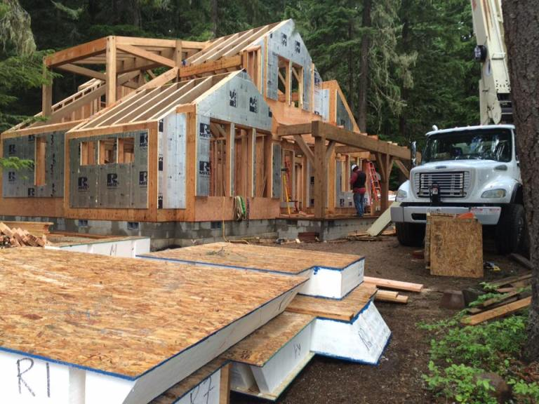 The timber frame and structural deck systems are construction of locally sourced Douglas fir and an envelope of Structural Insulated Panels (SIPs) roof system with prefabricated wall panels. Many timbers and posts in the frame were 10″x18″, a fairly robust size.