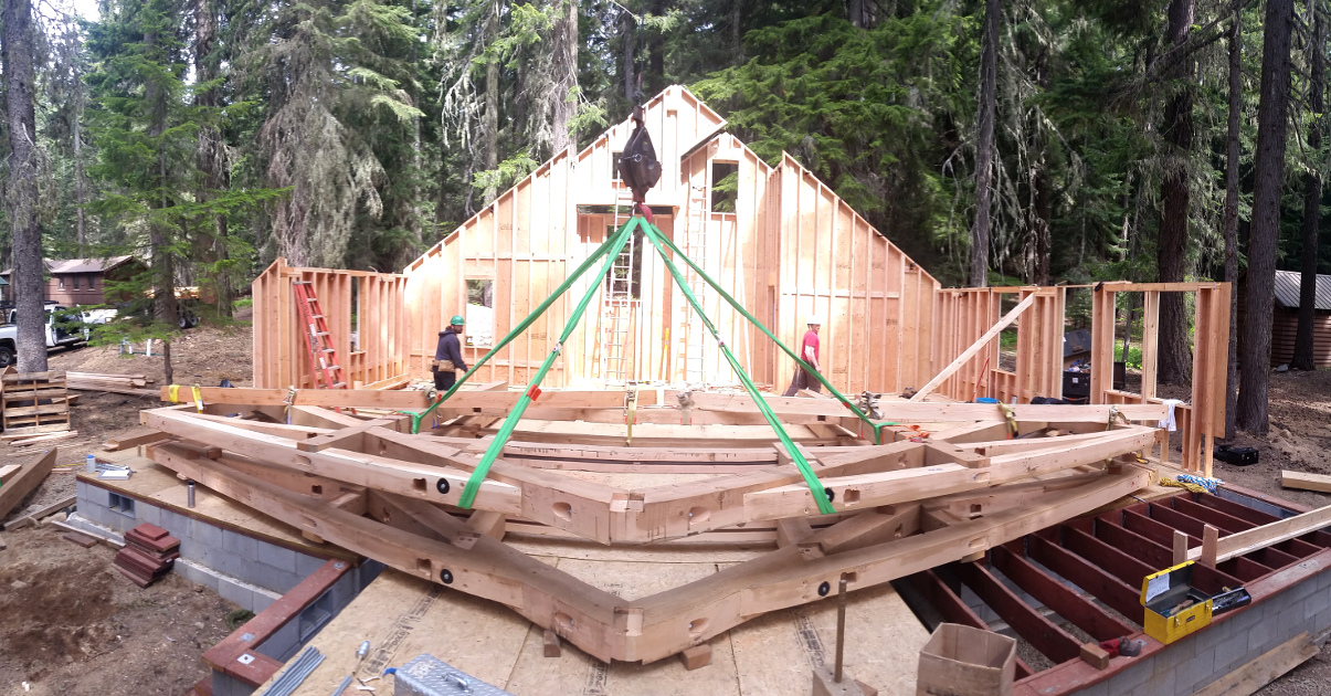 Timber bents are pre-assembled on-site, stacked on the deck and ready to be raised for the Odell Lake cabin.