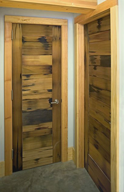 Interior doors, crafted from reclaimed vat stock celebrate signs of previous life.
