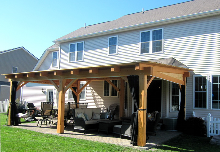 Post and beam timber construction often works best when space doesn't allow for full trusses.