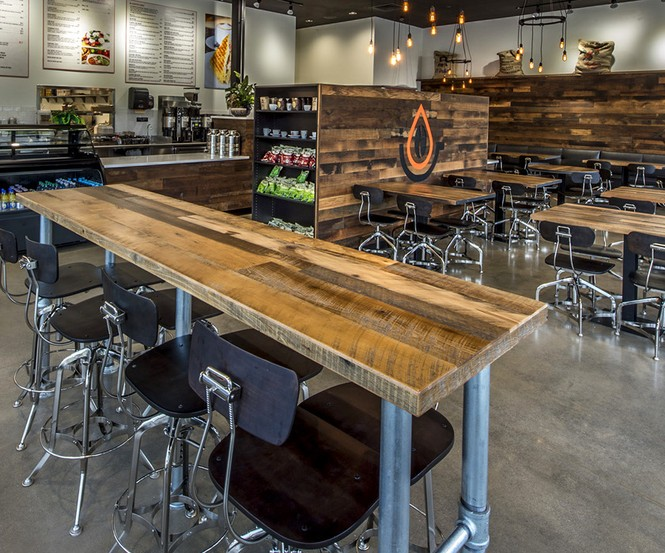 Pressed Cafe incorporated reclaimed hardwoods with original surfaces and a CNC logo from the NEWwoodworks shop.